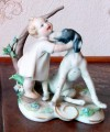Happy Child playing with the Dog Porcelain Figurine
