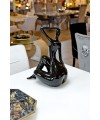 Ceramic ebony black sitting lady in our showroom from the back