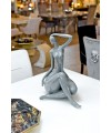 Ceramic grey sitting lady in our showroom
