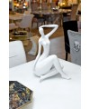 Ceramic white sitting lady in our showroom