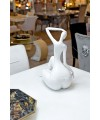 Ceramic white sitting lady in our showroom from the back