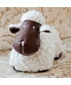White sheep door stop as seen in our showroom