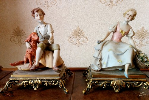 Boy and Girl Porcelain Figurines