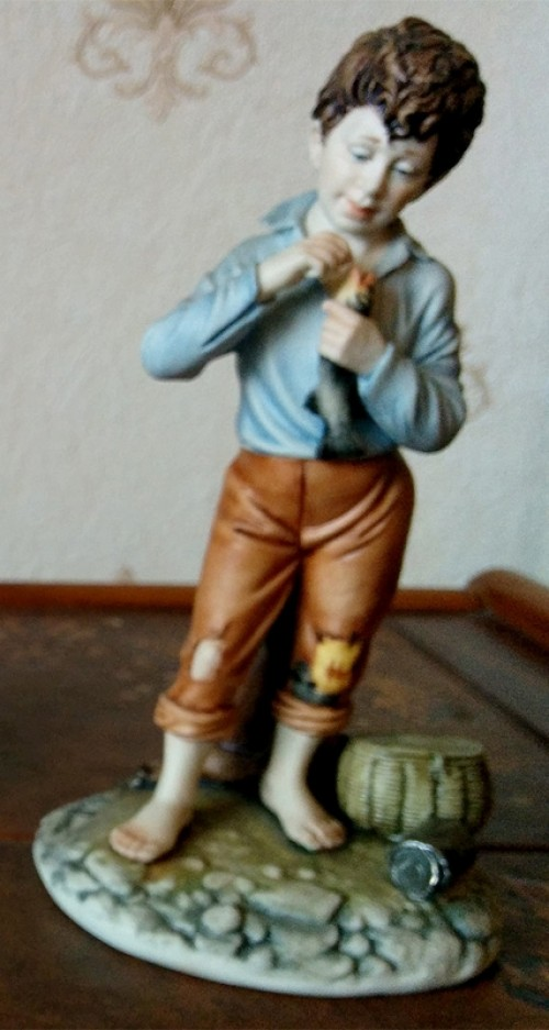 Boy with Fish Porcelain Figurine