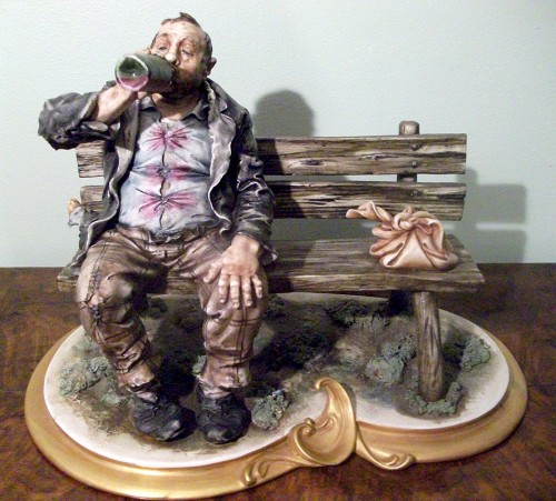 Capodimonte Tramp On Bench Drinking From Bottle Tramp
