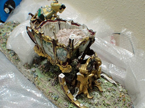 Capodimonte Coach and Horses being repaired by hand