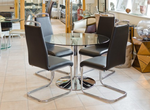 Clear Glass Round Dining Table in our Showroom