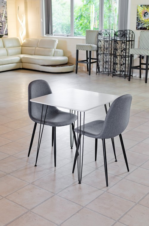Tower square white dining table with matching grey chairs