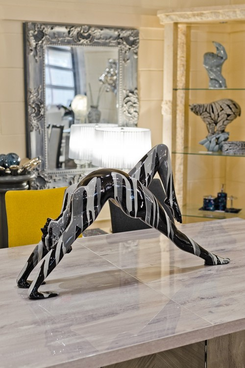 Amorous red yoga lady sculpture in our showroom