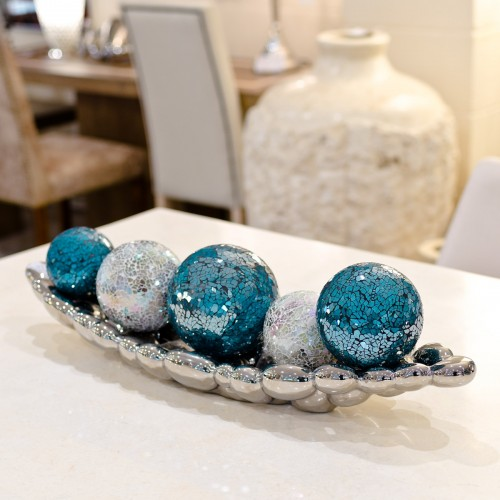Blue and natural mosaic glass balls in a ceramic chrome dish