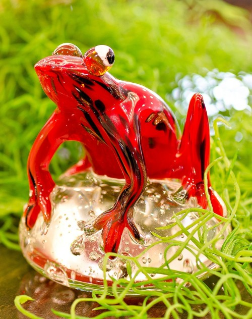 Glass Red Jungle Frog Paperweight in our showroom
