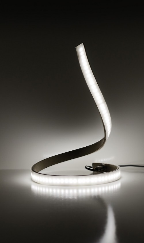 LED Snake Table Lamp - On display in a dark room