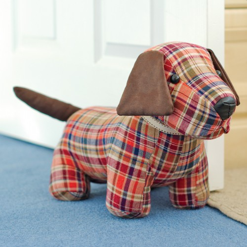 Red tartan doggy door stop plush as seen in our showroom