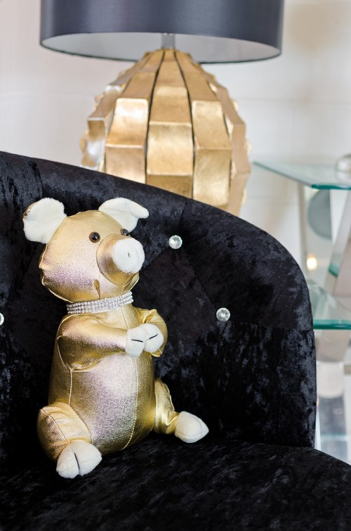 Golden Pig Door Stop in our showroom